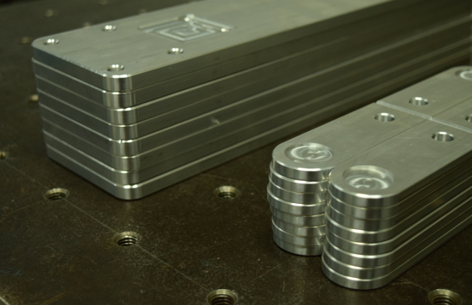 CNC machined aluminum mounting plates.
