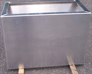 Aluminum cabinet with formed edges and seam welded.
