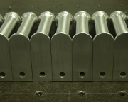 Aluminum round handles welded onto CNC machined mounting plates