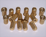 Brass knurled inserts with internal threads.