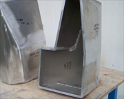 Aluminum prototype panel covers used to create casting moulds.